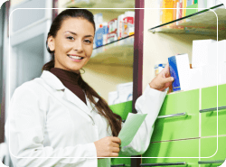 pharmacist smiling in a drugstore