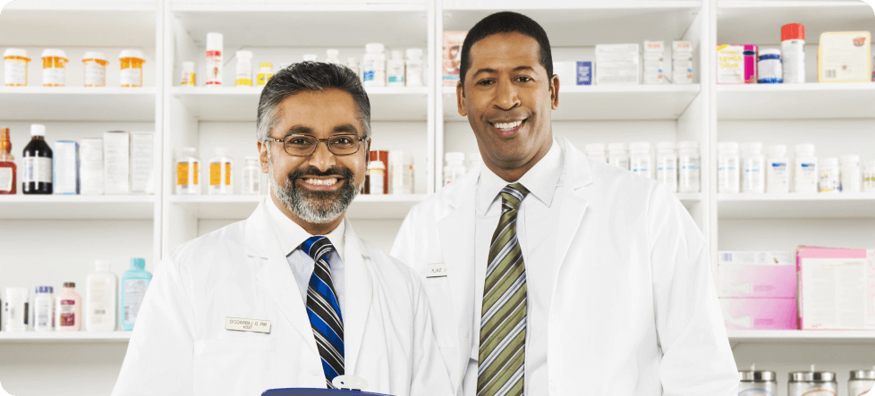 two multiethnic pharmacists smiling