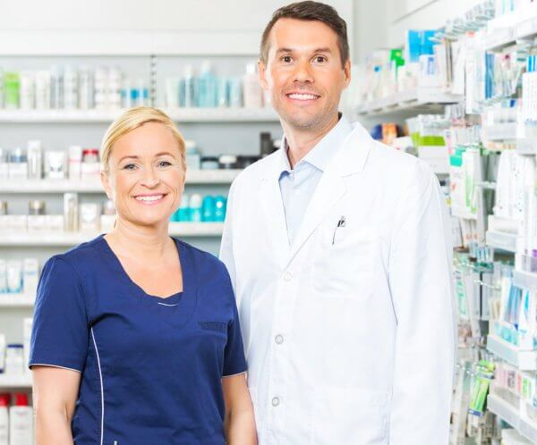 pharmacist and her assistant smiling