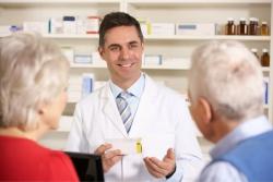 pharmacist talking to a senior couple