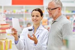 pharmacist and senior customer checking a prescription